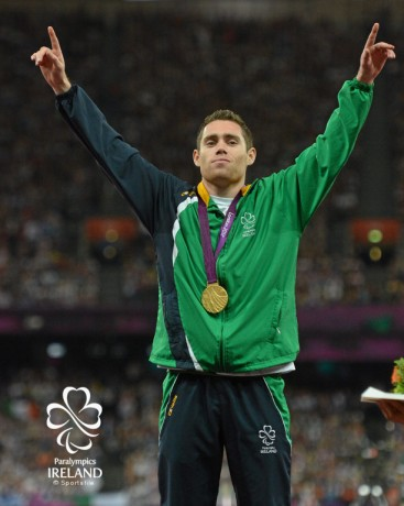 7 September 2012; Ireland's Jason Smyth, from Eglinton, Co. Derry, celebrates with his gold medal after winning the men's 200m - T13 final. London 2012 Paralympic Games, Athletics, Olympic Stadium, Olympic Park, Stratford, London, England. Picture credit: Brian Lawless / SPORTSFILE *** NO REPRODUCTION FEE ***