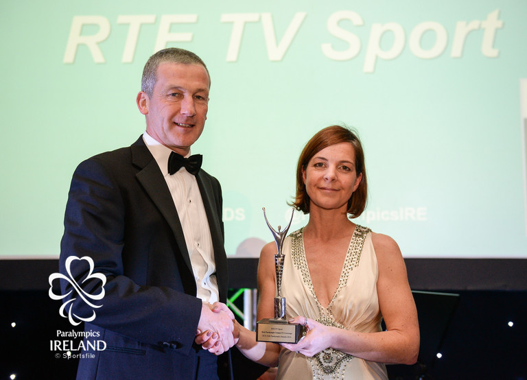 Cliona O'Leary, right, of RTÉ Sport, accepts the prize for Best Paralympic Games TV Coverage, from Cecil Ryan, OCS Europe, at the OCS Irish Paralympic Awards