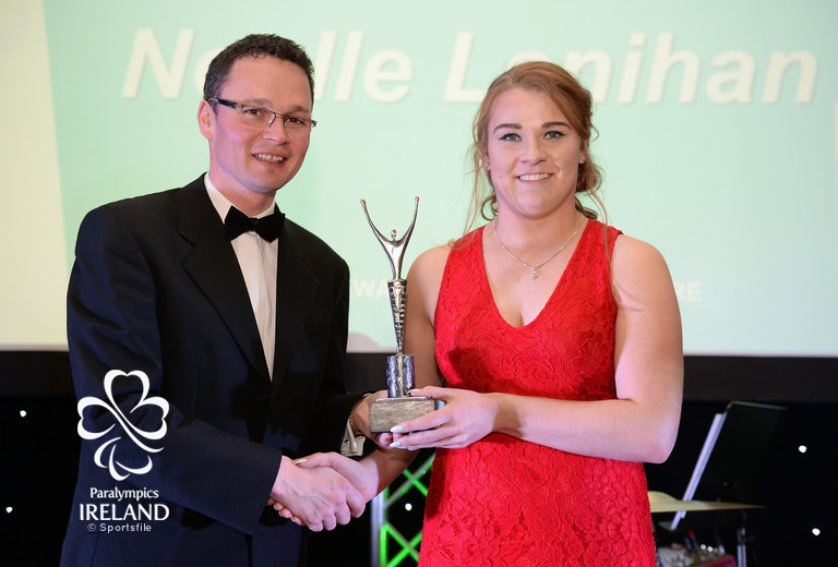 Noelle Lenihan accepts the award for Young Paralympian of the Games, from Minister of State for Tourism and Sport Patrick O'Donovan T.D., at the OCS Irish Paralympic Awards
