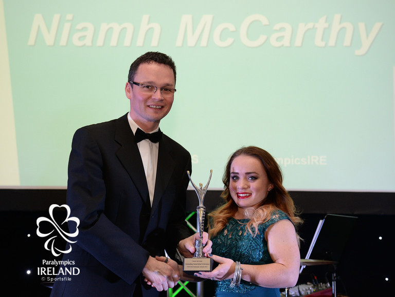 Niamh McCarthy accepts the prize for Outstanding Games Debut, from Minister of State for Tourism and Sport Patrick O'Donovan T.D., at the OCS Irish Paralympic Awards