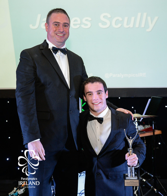 James Scully, right accepts his prize for Outstanding Team Member (Athlete), from Dave Malone, Irish Paralympic Performance Director, at the OCS Irish Paralympic Awards