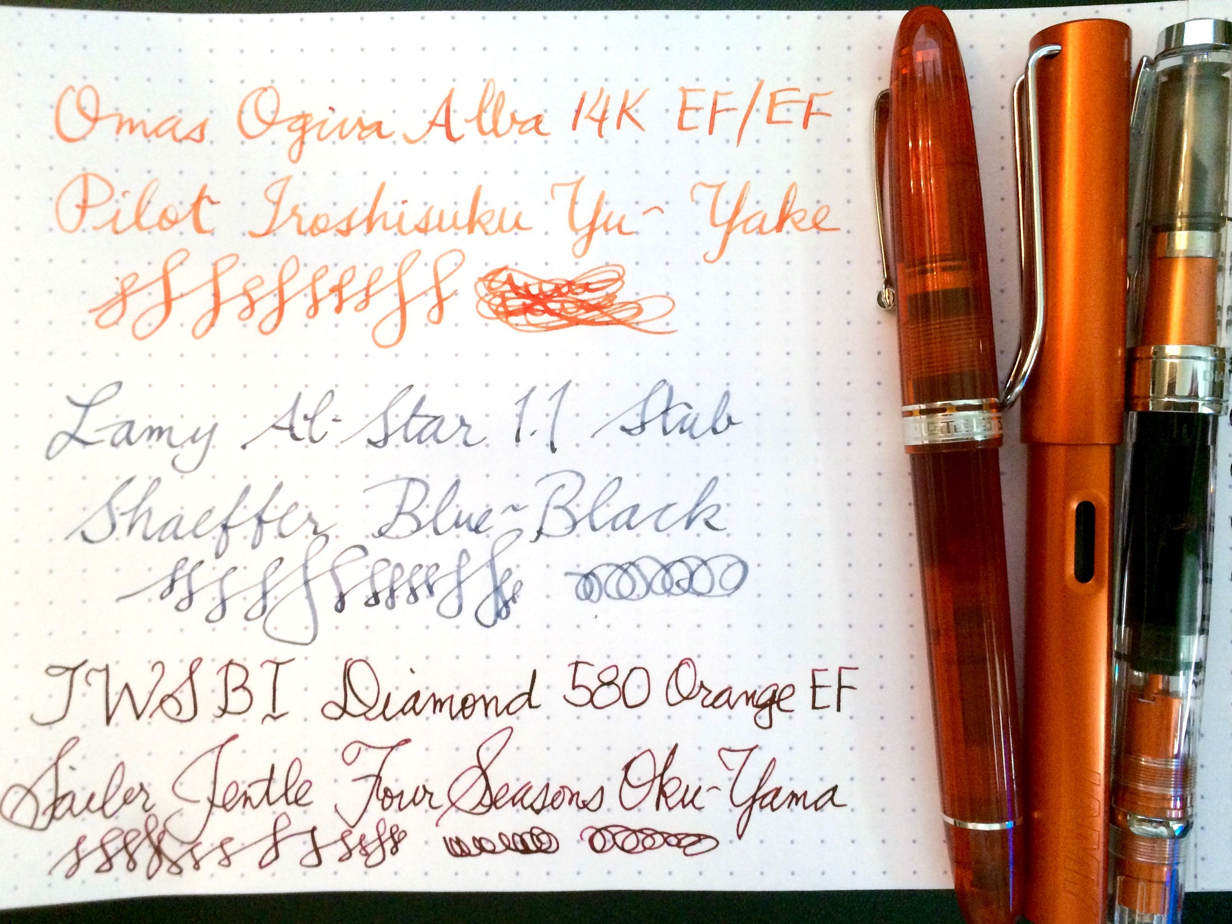 Writing samples with orange pens