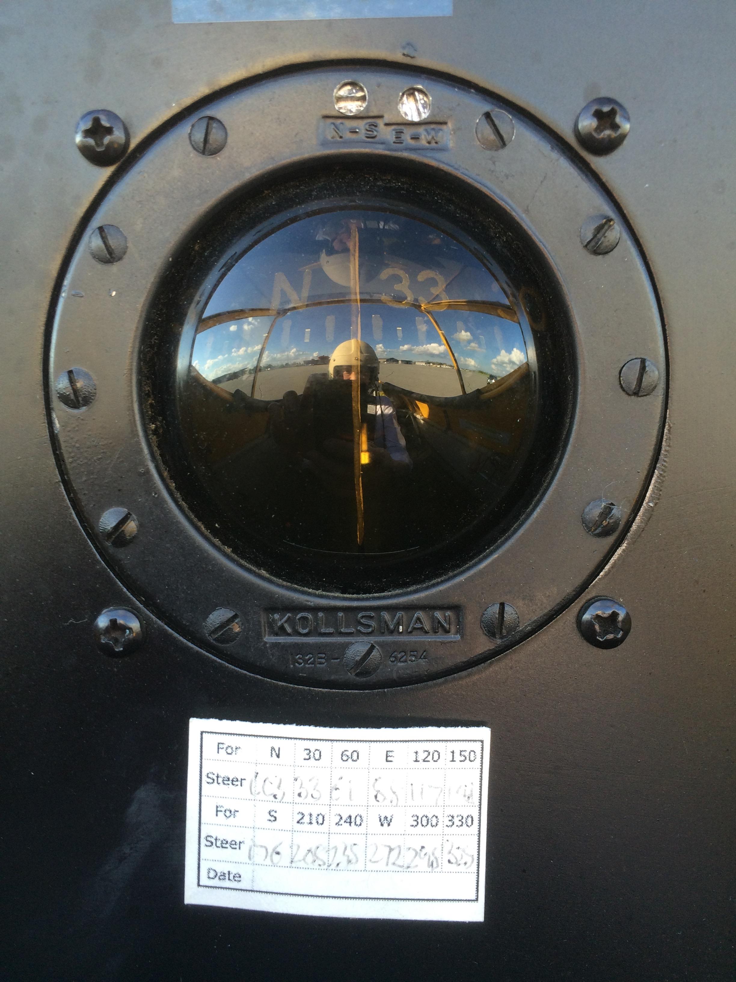 Me looking into an instrument gauge.
