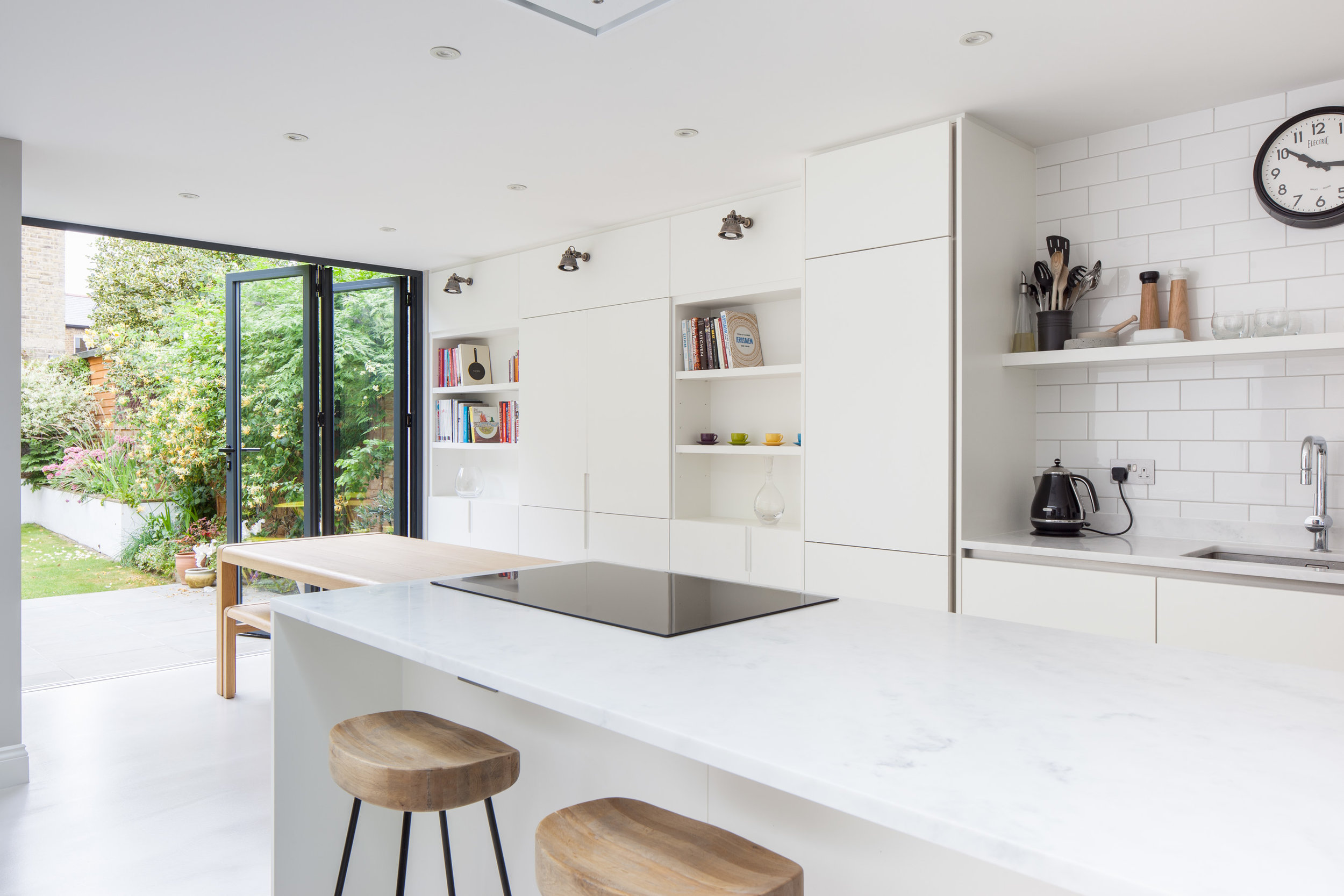 Crisp white interior to house extension by Thomas & Spiers