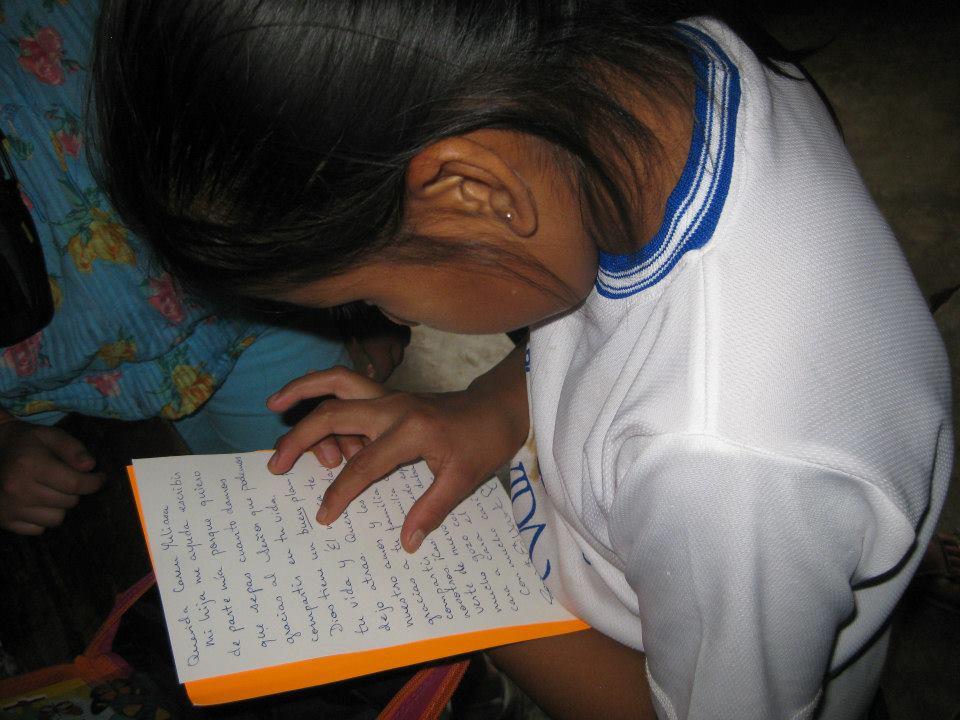 One of the sponsor children reading a letter from her sponsor.