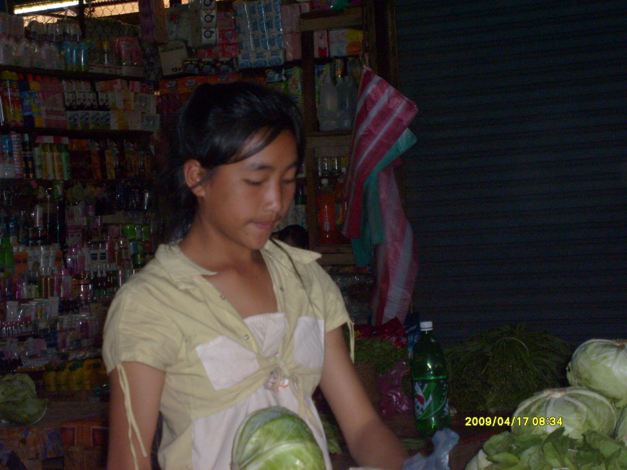 This 12-year-old girl mans her mother's produce booth at the wet market single-handedly from dawn to dusk every day.