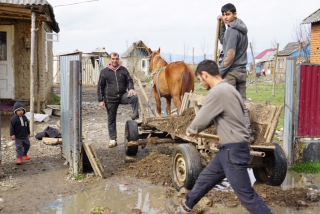 Using equipment purchased through donations, Ukrainian gypsy workers make and sell concrete blocks to build homes in their village and help support their families.
