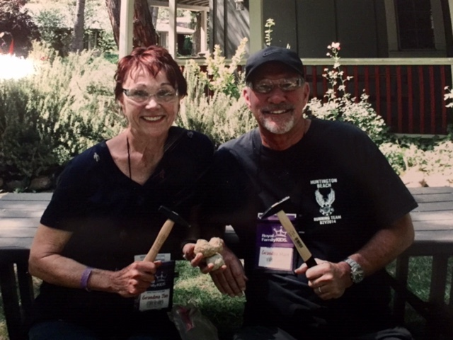 """Jan & Mark Armando getting ready to help the kids crack open their geode rocks.  """"Rough looking on the outside, but beautiful crystals on the inside. They get to keep their geodes to remind them that God loves them and it's what's on the inside that counts and God sees them as beautiful."""""""