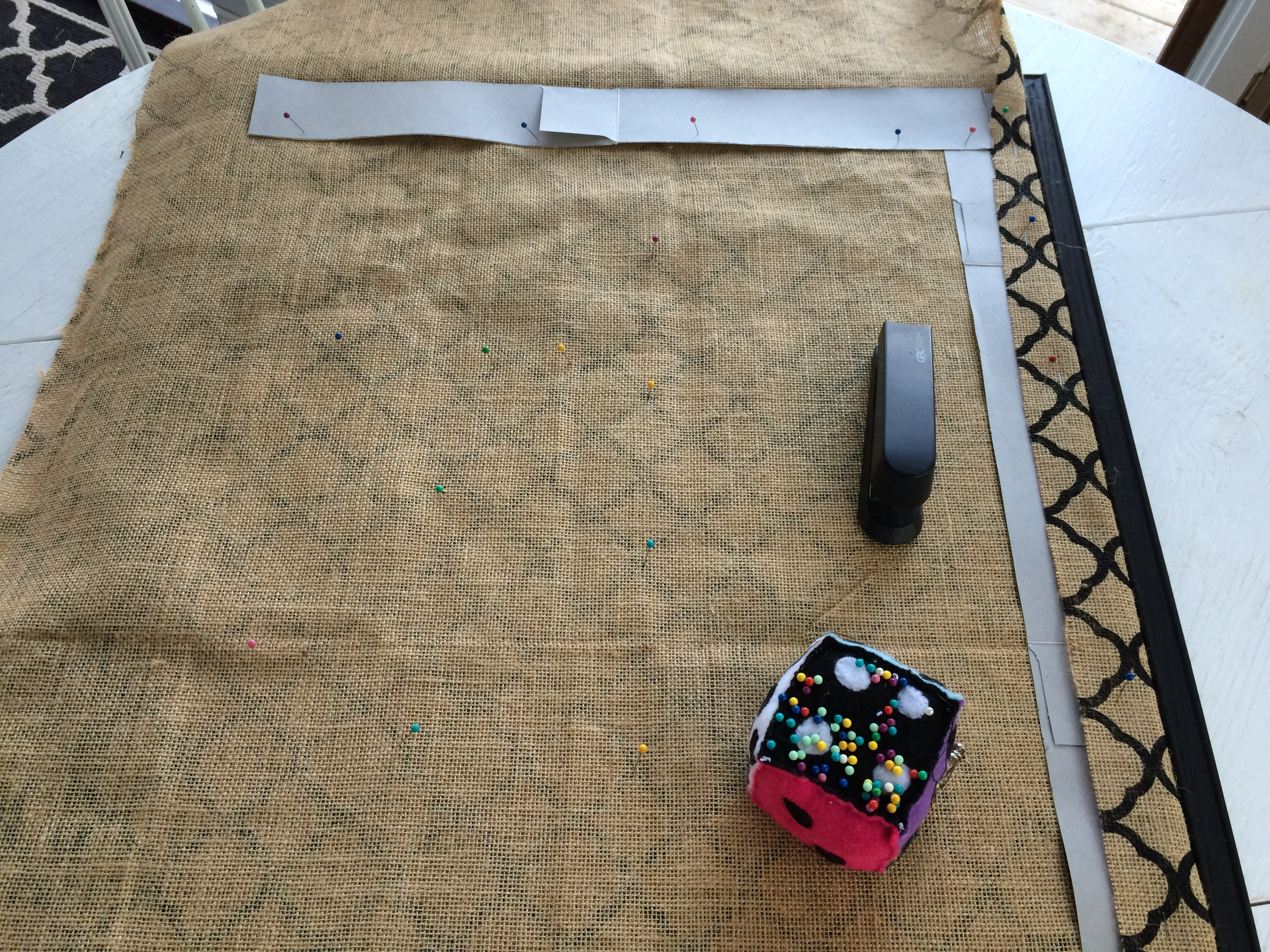Cardboard strips with burlap folded and stapled to them.