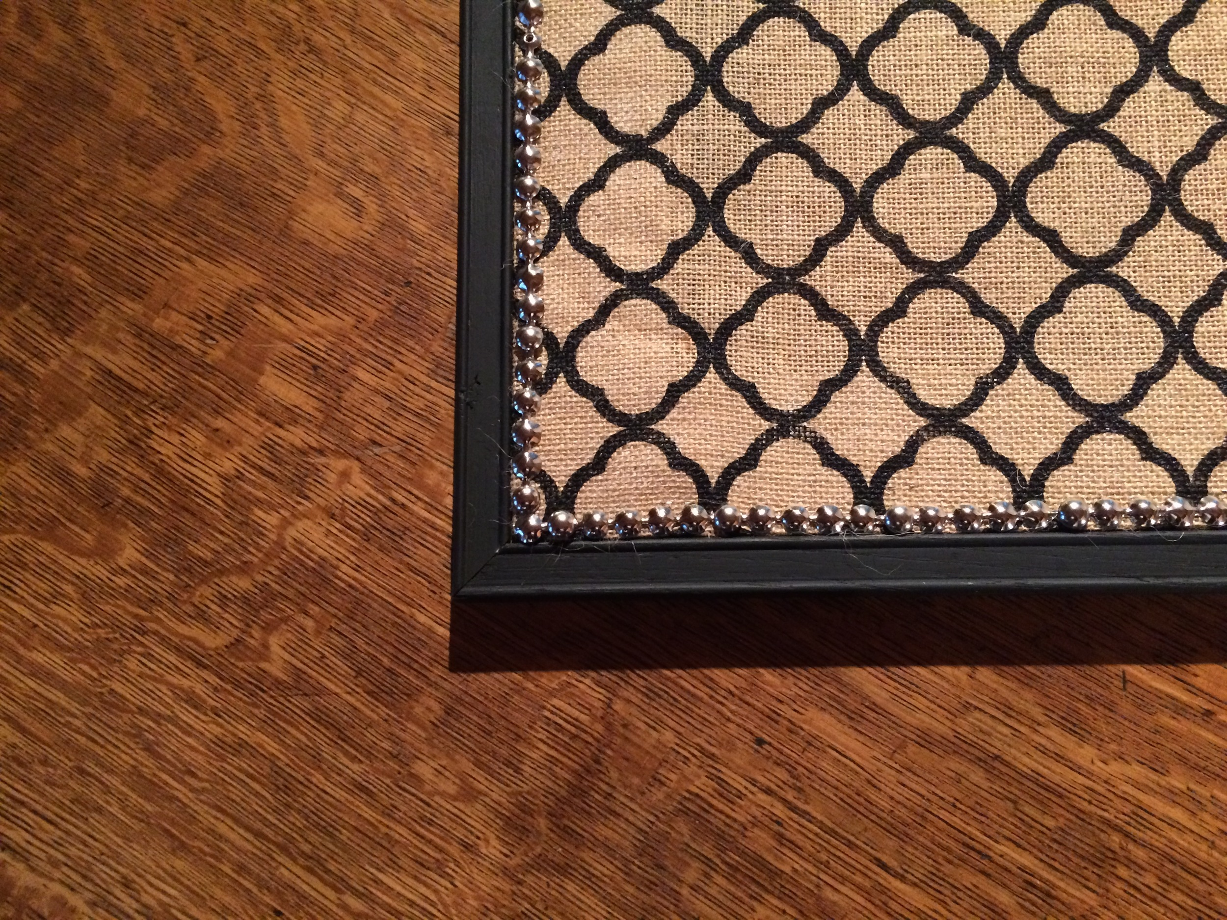Love the contrast of the rough burlap against the smooth shiny trim.