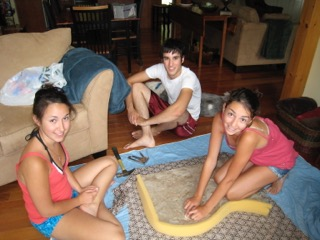 Throwback! My three children upholstering the chaise in the original maroon fabric.