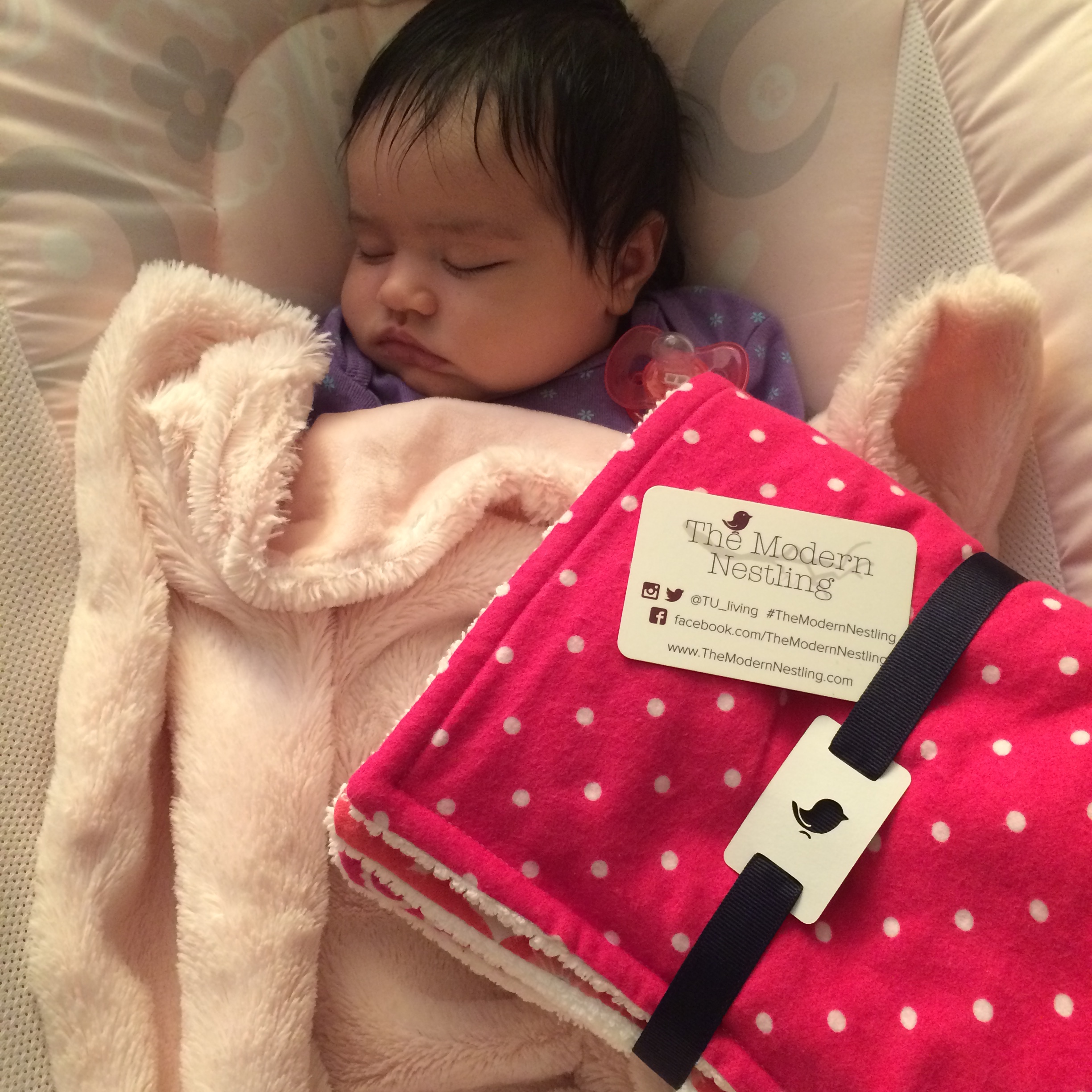 This sleepy little nestling woke up to a set of  Pretty in Pink  TMN burp cloths, Lucky her!! # TheModern    Nestling