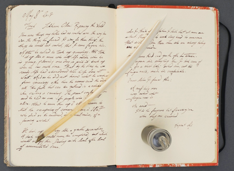 Tim McLaughlin's Torah: a modified notebook of his writing, goose quill hand-cut by the artist, glass bottle of iron-gall ink made by the artist.