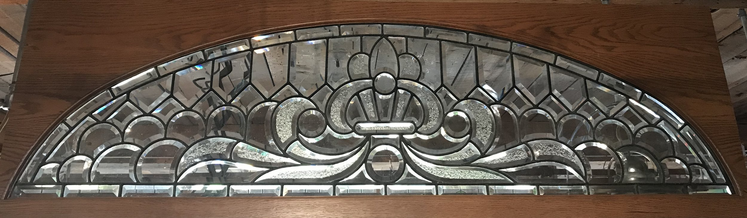 Exceptional Beveled and Leaded glass arched transom