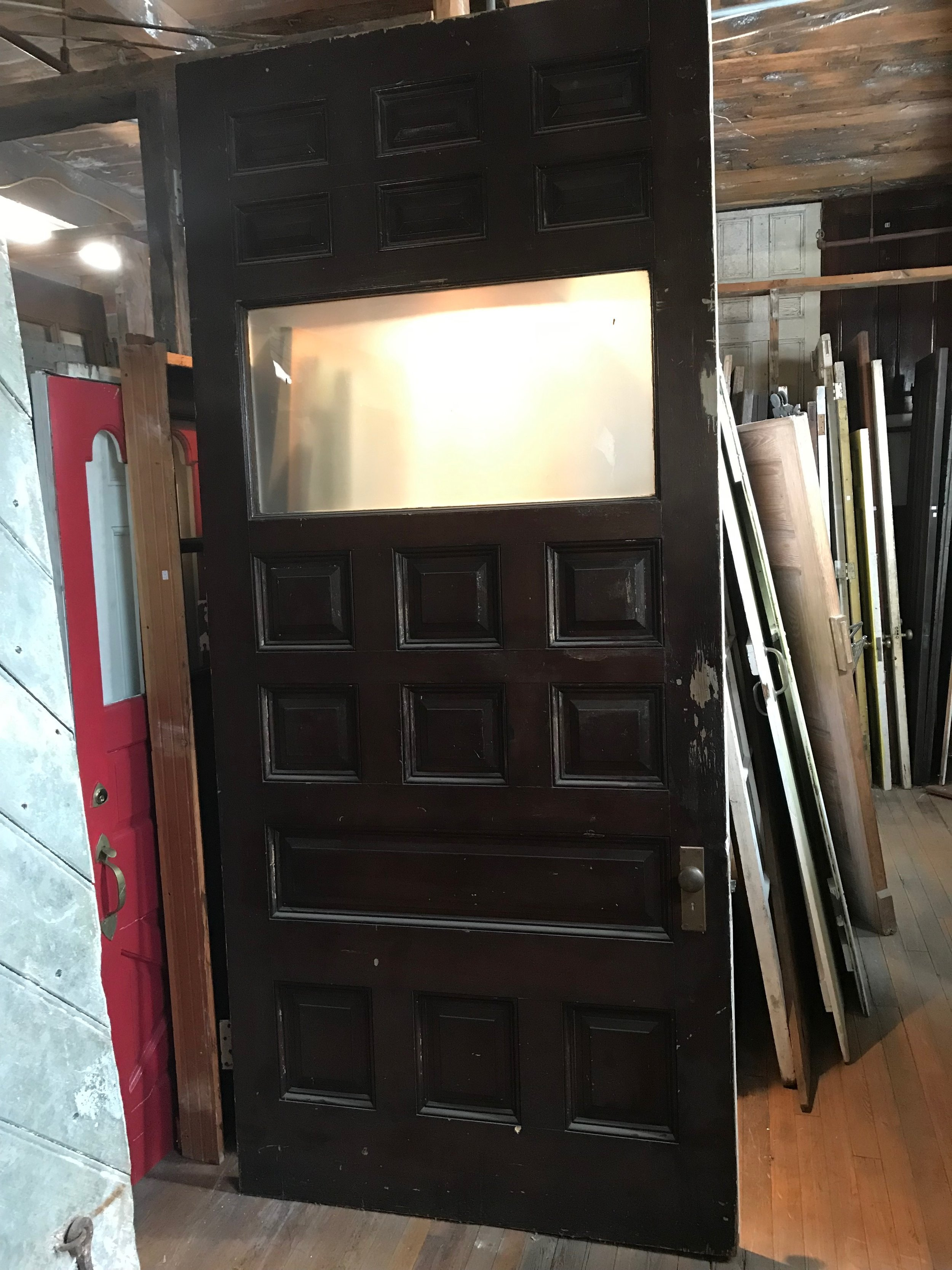 Oversized antique paneled entry door