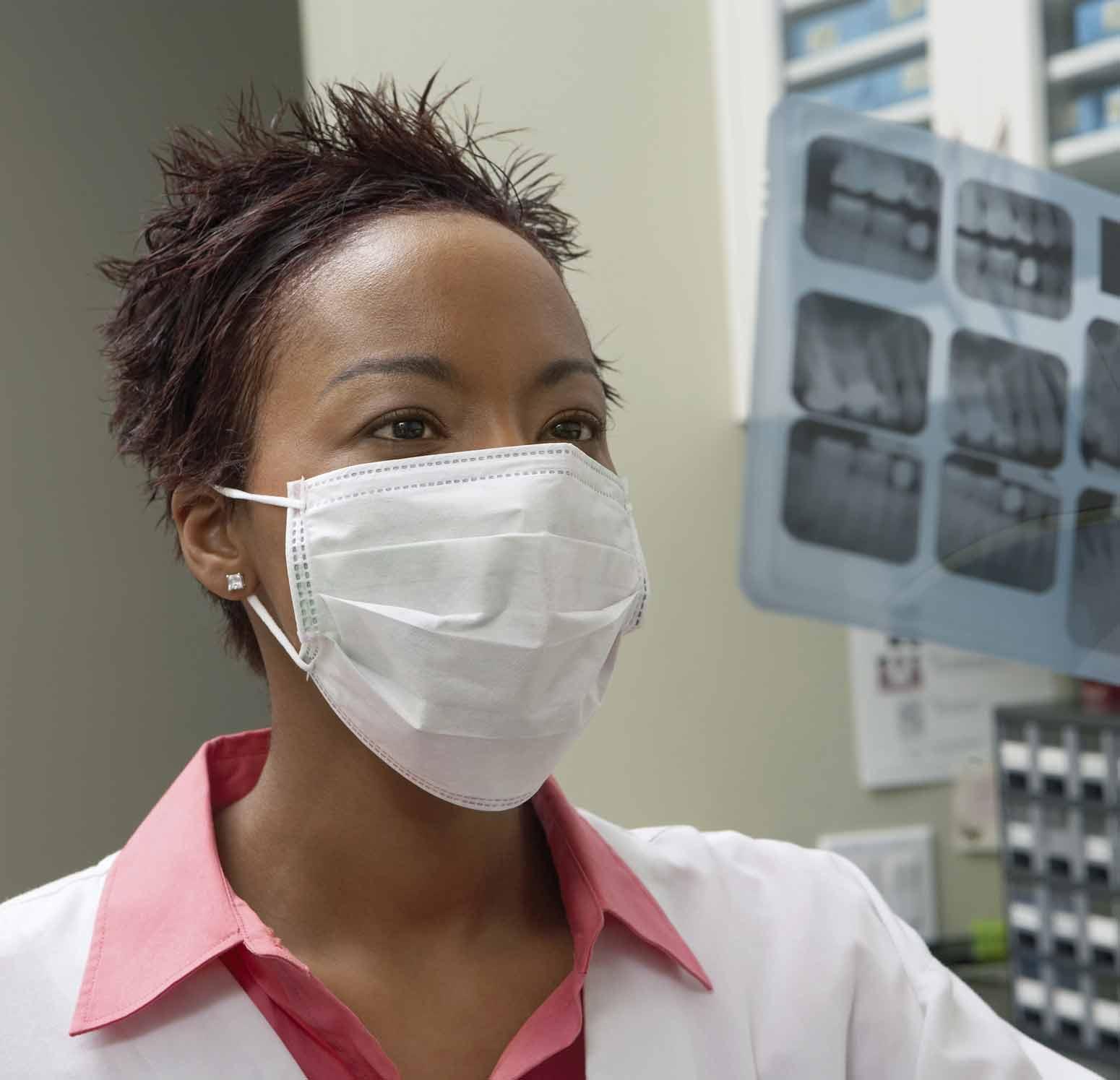 Dentist reading dental x-rays
