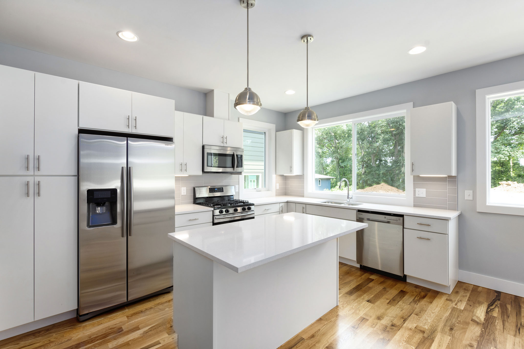 Gourmet Kitchen with Quartz Countertops and Stainless Appliances.jpg