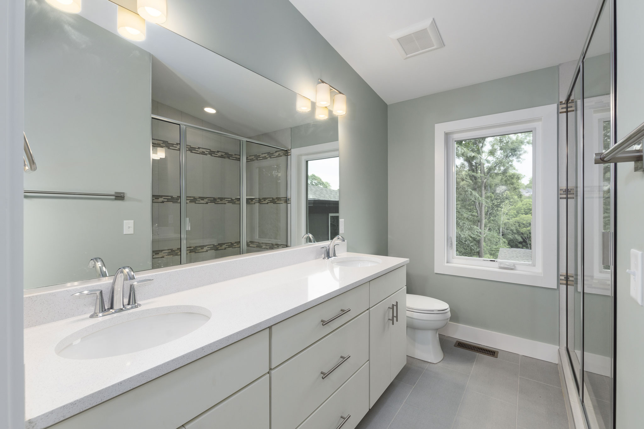Master Bathroom with Quartz Double Vanity and Walk-In Shower.jpg