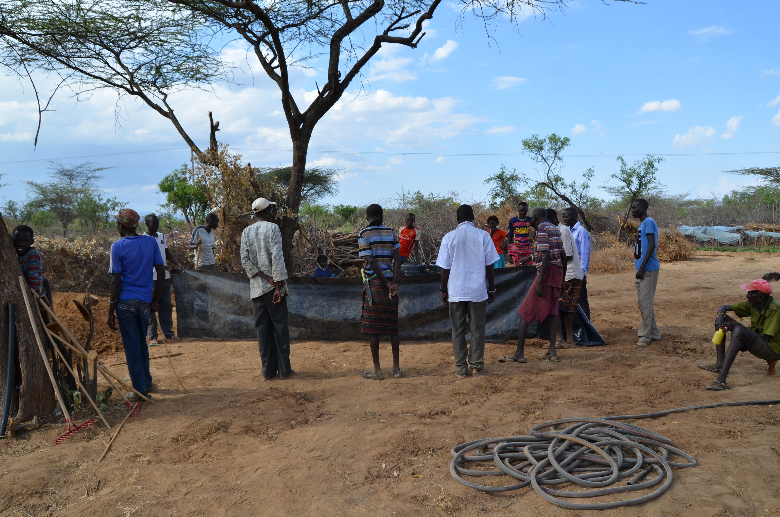 Learning how to create a sand dam:  harvesting rain water a valuable topic we cover during our intensive farm training.