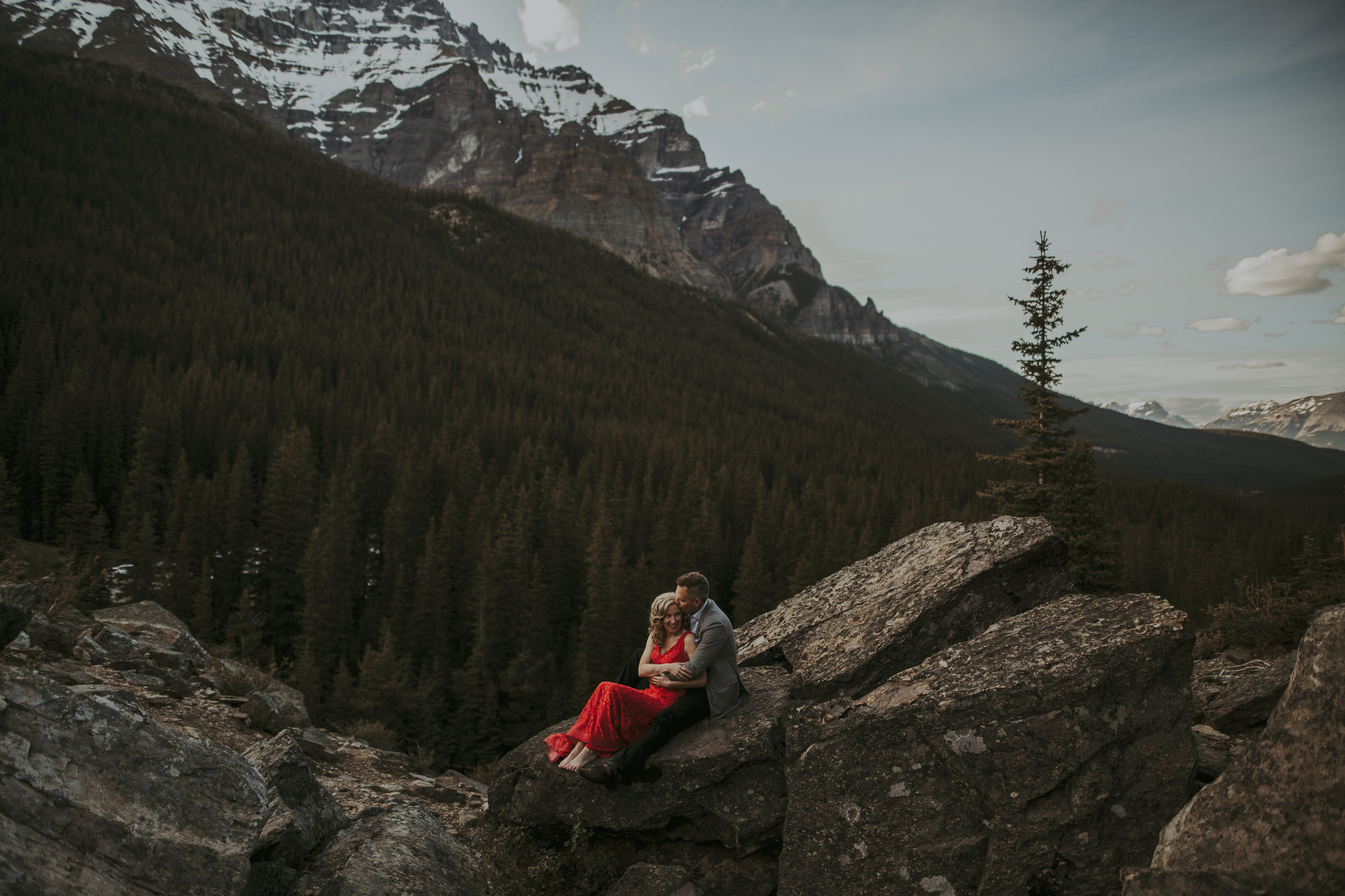 Red Dress Engagement Couple - Banff Canmore Calgary Cochrane Photographer