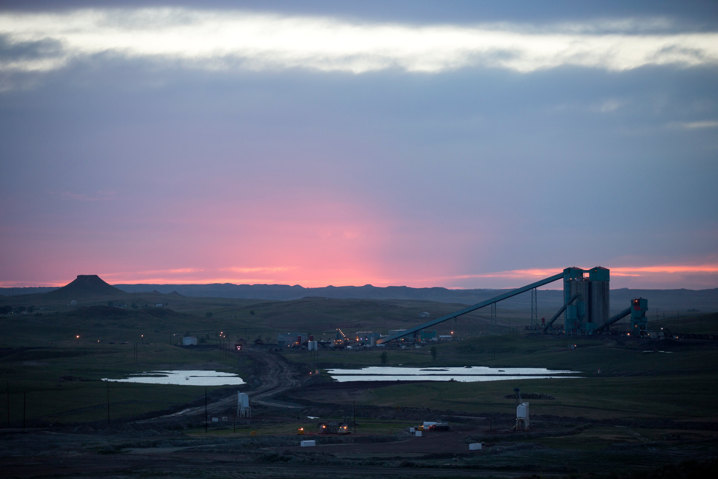 The sun sets over Eagle Butte coal mine as seen outside Gillette, Wyoming, Friday, June 10, 2016. The mine, operated by Alpha Coal West, Inc., is one of about a dozen mines in the Gillette, Wyoming area. Alpha Natural Resources, Inc., filed for bankruptcy in August 2015. (Kristina Barker for The New York Times)