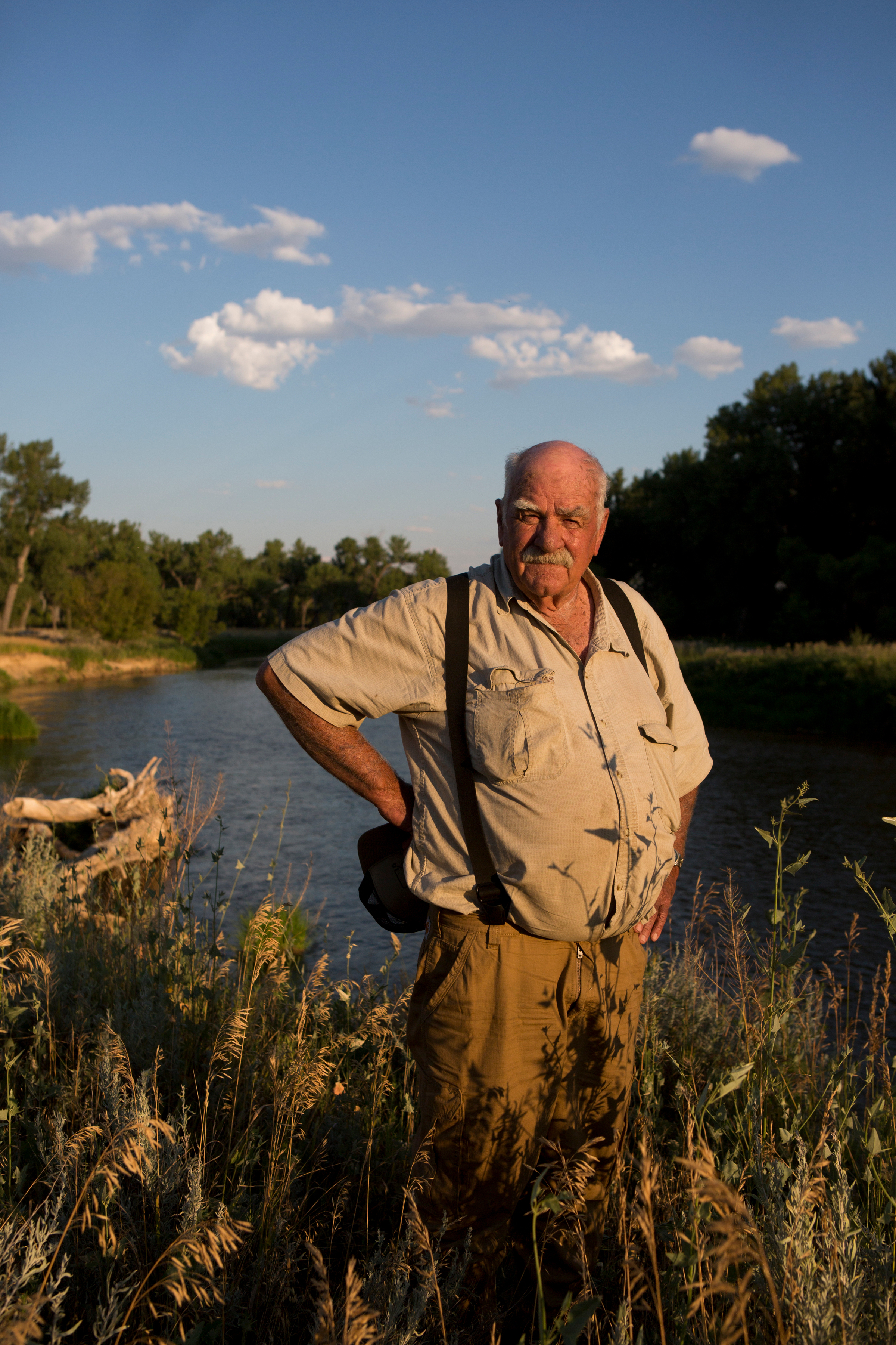 """Art Hayes, pictured here along the Tongue River near Birney, Montana, on his ranch that has been a part of his family since his great grandfather settled on the Three Circle ranch in 1886. """"I love that peace and quiet,"""" Mr. Hayes explains about his love for being a steward of the land. """"It's my little piece of heaven and I'm going to fight for it. """"Even my great grandfather said, 'You're not going to make it without irrigation,'"""" he recalls his father saying. """"It's just vital to us. We're here for the long run. It's (the land) is very productive. But it takes water."""" Residents in Montana's coal country debate the benefits natural resource extraction brings to the region with the damaging effects of water contamination. While the high-paying jobs brings much-needed prosperity to some of the area's communities, the presence of coal mining some argue threatens the livelihood of those who depend on clean water for agriculture. (Kristina Barker for The New York Times)"""