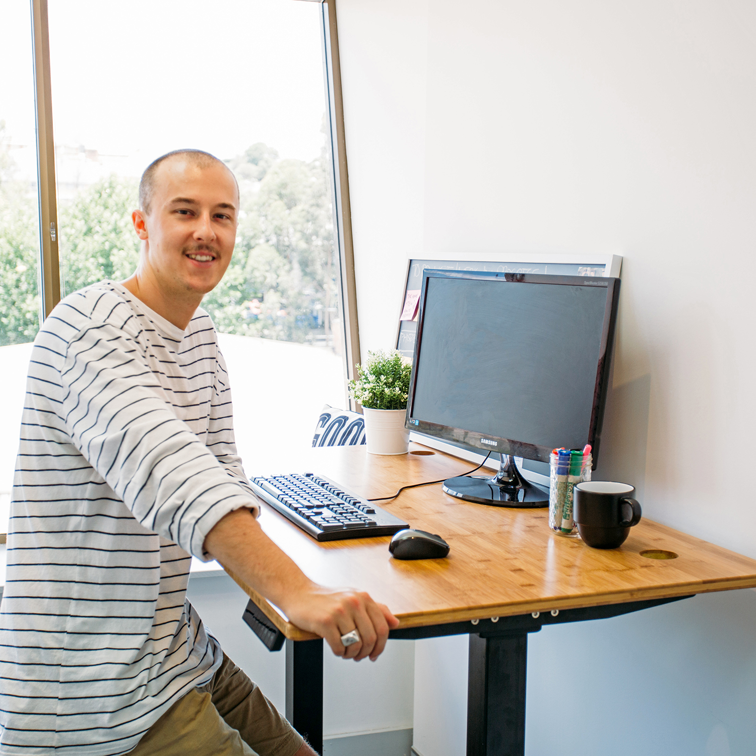 electric standing desks with bamboo - office space set up