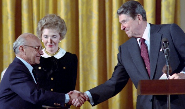 Milton Friedman and Ronald Reagan. Photo via Wikimedia Commons.
