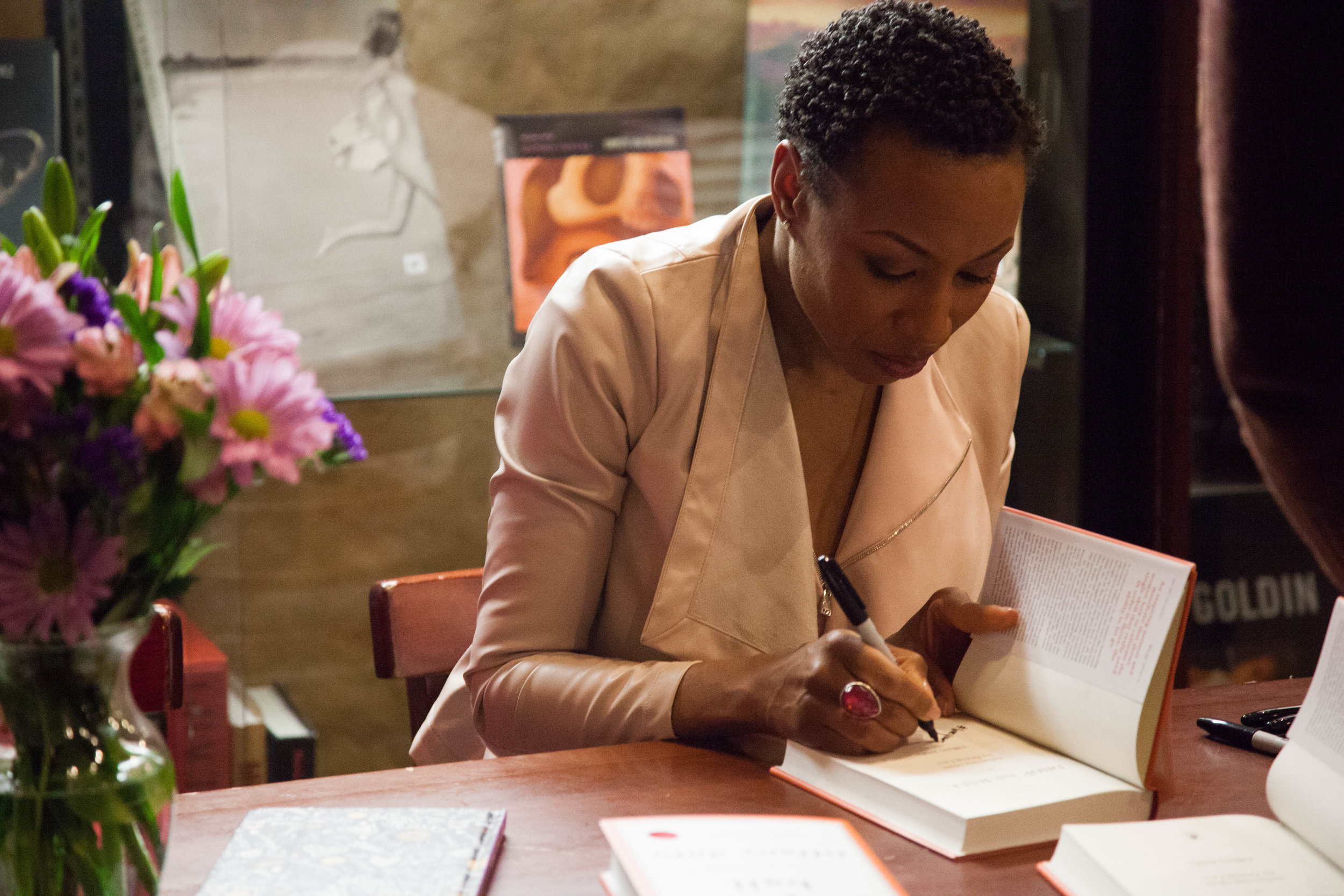 Tiffany Dufu signs copies of  Drop the Ball . Photo courtesy of Tiffany Dufu.