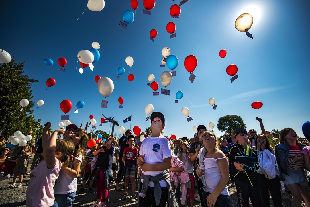 French children release balloons for a 2017 D-Day remembrance ceremony. Photo by Senior Airman Devin Boyer via the U.S. Air Force