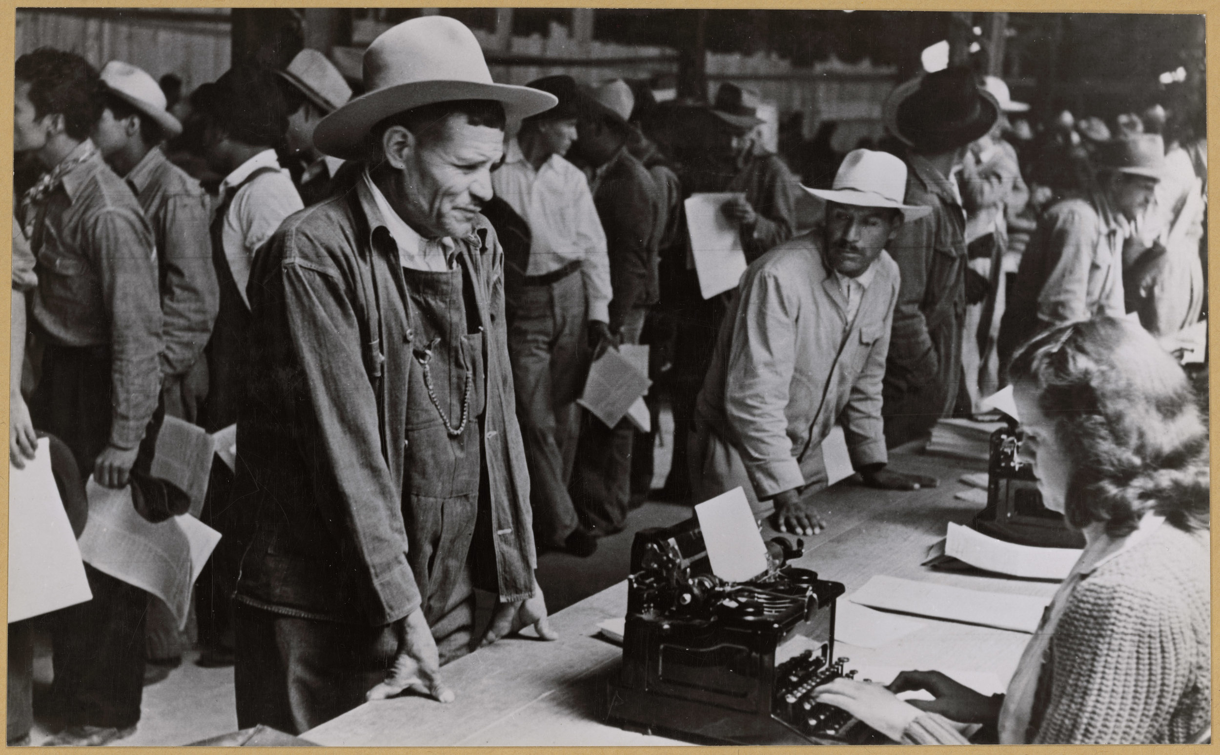 Mexican farmers who have been accepted to the Braceros Program, circa 1942- 1945. Photo via National Archives.