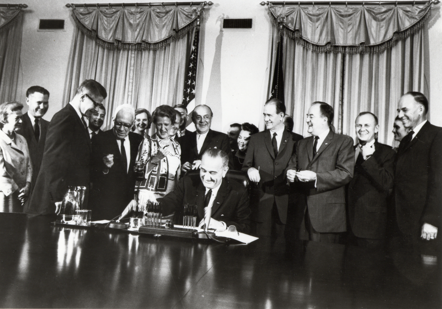 U .S. President Lyndon B. Johnson signing the Food Stamp Act of 1964. Photo via USDA