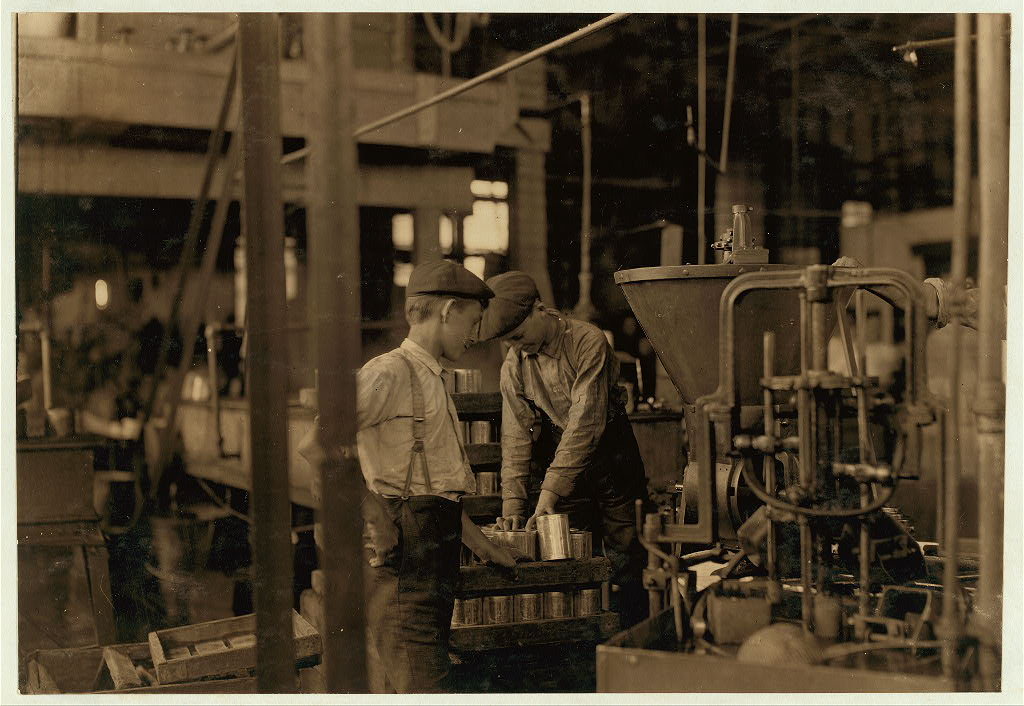 Boys at a canning factory. Image via Library of Congress