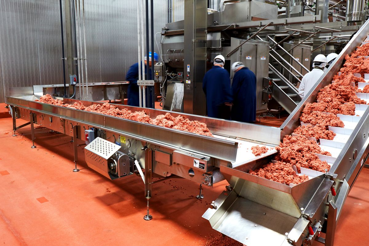 Plant-based 'meat' rolls down a conveyor belt in Impossible Foods' Oakland plant. Photo via Impossible Foods.