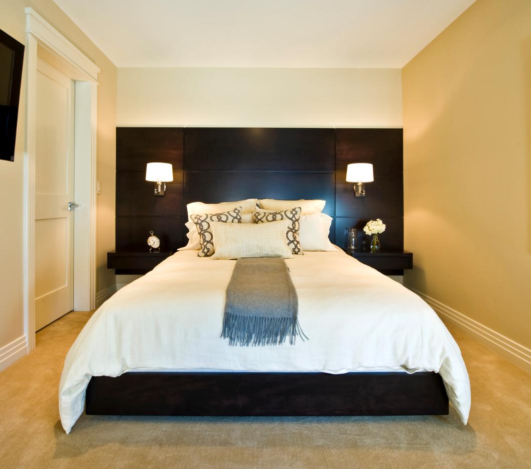 custom-dark-wood-platform-bed-wall-mounted-nightstands.png