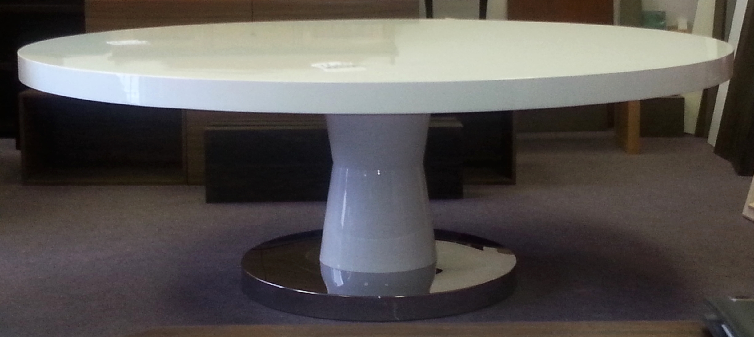 high-gloss-white-round-sculptural-dining-table.jpg