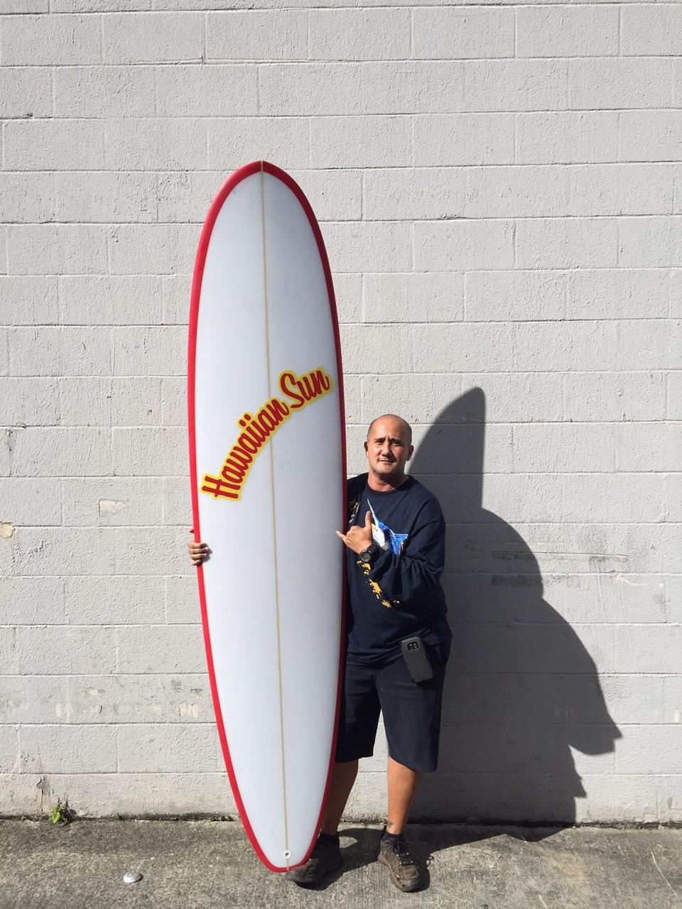 Joe Ng, winner of the Hawaiian Sun surfboard