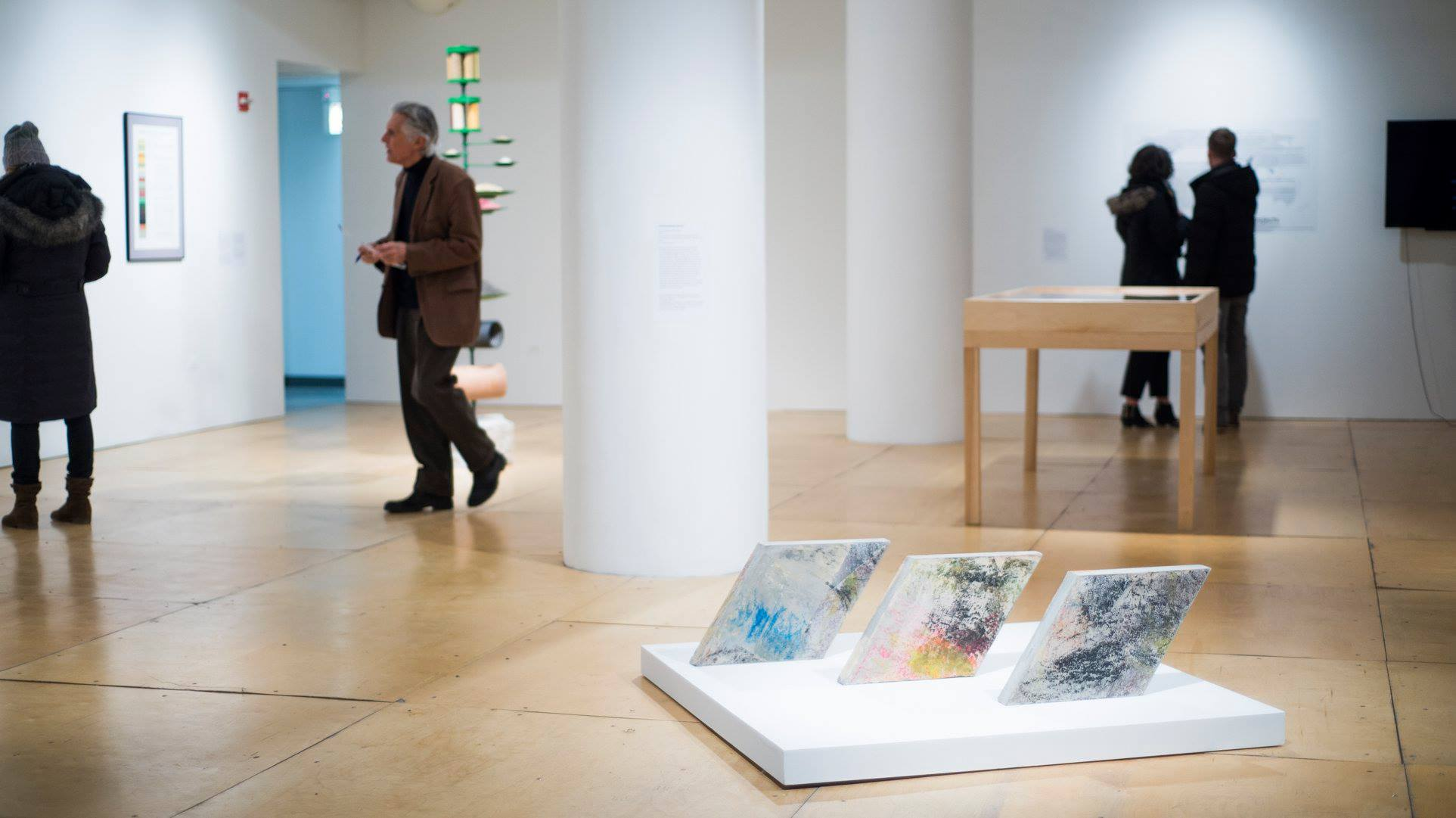 Installation photograph of  Scenography of Friendship  cast concrete, collaborative oil pastel rubbings with Mehmet, Fatma, Eyüp, Sudenaz, Yağmur, and Yaren. Photo courtesy of Gallery 400.