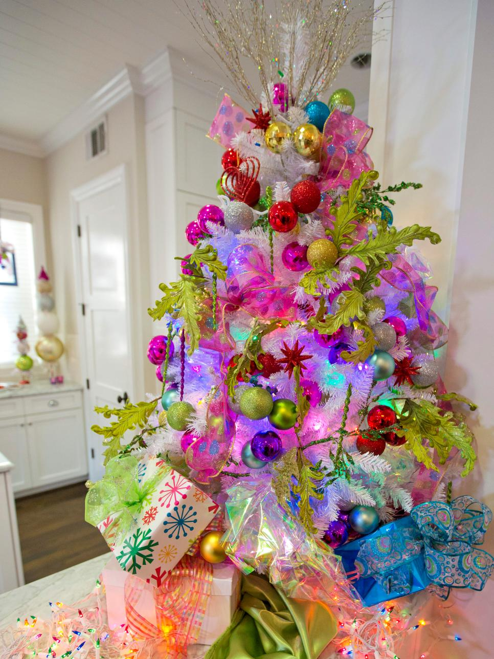 For the playful and eclectic Fashionista, this tree is the only option Leaves, ornaments, holographic paper and actual presents fill this tree on wonder.