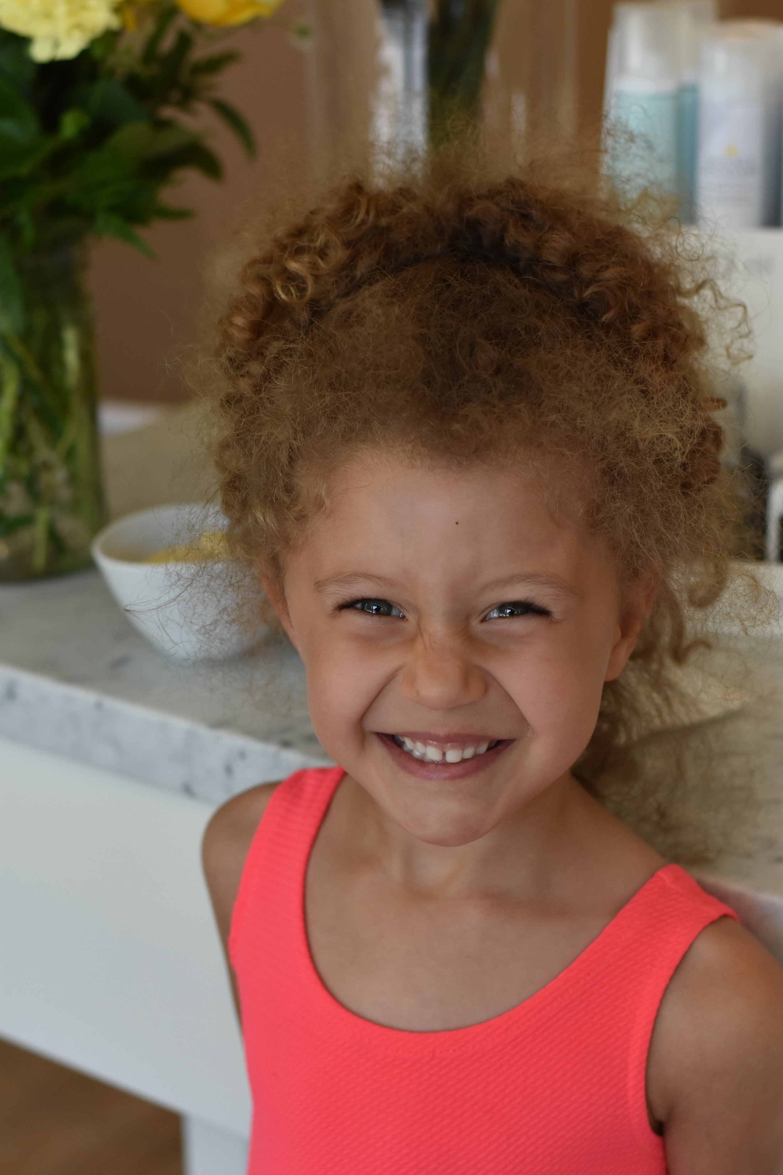 before picture of little girl with curly hair at DryBar salon.