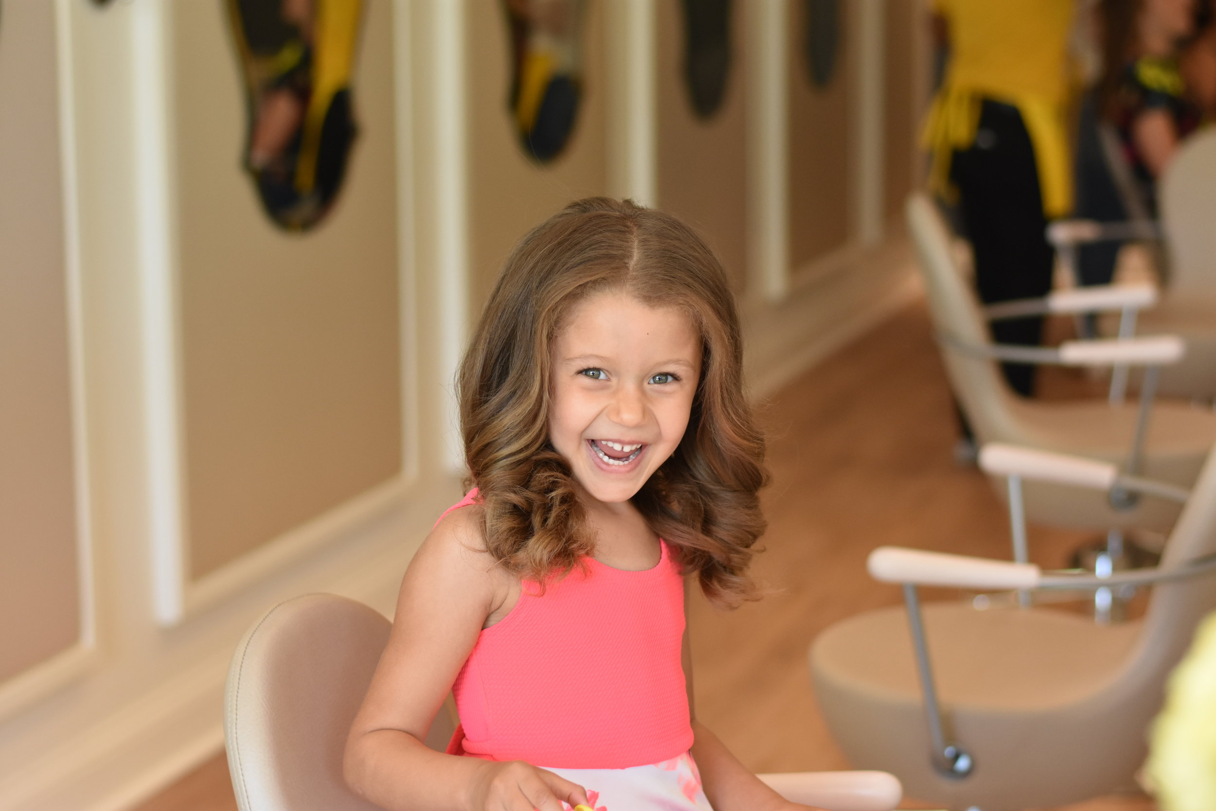 Image of little girl with new hairstyle at DryBar salon in Indianapolis.