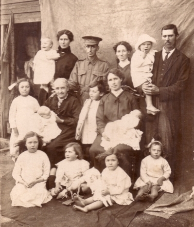 Back row: Ida May (Jacka) King holding Charles William King, Robert Arthur Kent Jacka, Rose Victoria Jacka, Samuel Hall Jacka, possibly holding son Clarence Samuel. Middle row: a daughter of Samuel Hall Jacka, Annie (Kent) holding Mavis Ida Jacka, daughter of Samuel, Lenard Roy Stevens, Mary Maria (Jacka) Stevens holding daughter Ilene Annie. Front row: another Samuel daughter, Stanley Albert Stevens, then two more grandchildren, possibly Edna May King and Evelyn Rose Jacka.