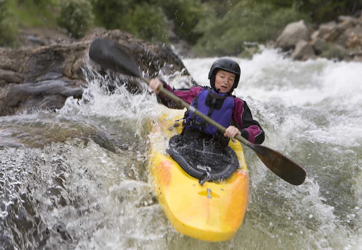 A kayaker in a whitewater competition ©iStock