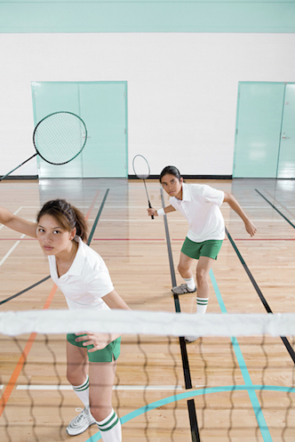 Four people can play a badminton match. Two players on each side of the net. iStock images