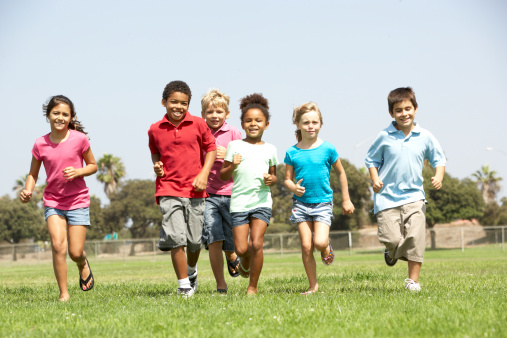 Running and playing makes you feel happy. Your brain tells you to smile! Getty Images