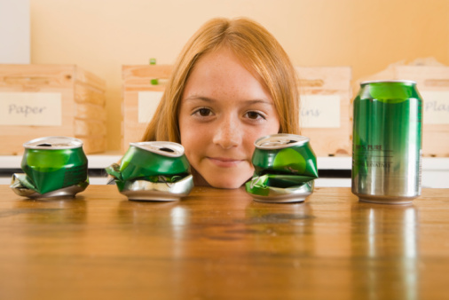 Recycling cans is good for the environment. Getty Image