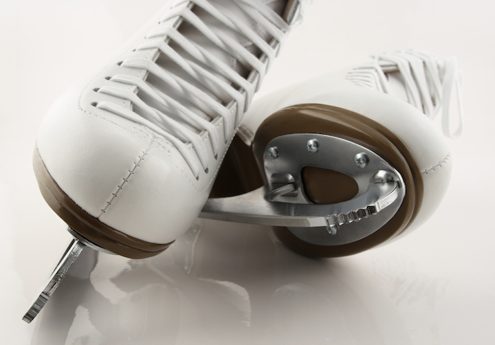 Ice skates are blades attached to firm boots. ©Getty