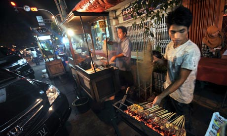 There are many street peddlers in the streets of Jakarta, selling food and souvenirs.