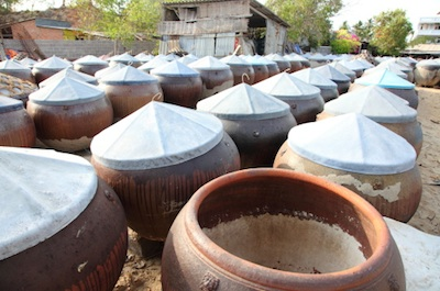 Terracotta barrels of fermenting fish sauce in Vietnam . Photo©Getty