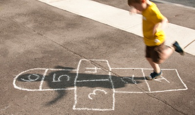 Playing hopscotch in the school ground ©Getty Images
